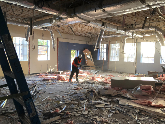 Ongoing Renovation and Restoration - Crew Worker inside building