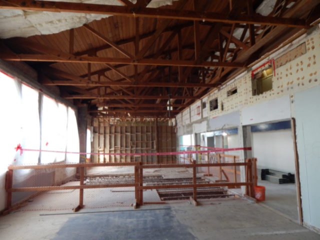 Image of wooden trusses on second floor during renovation