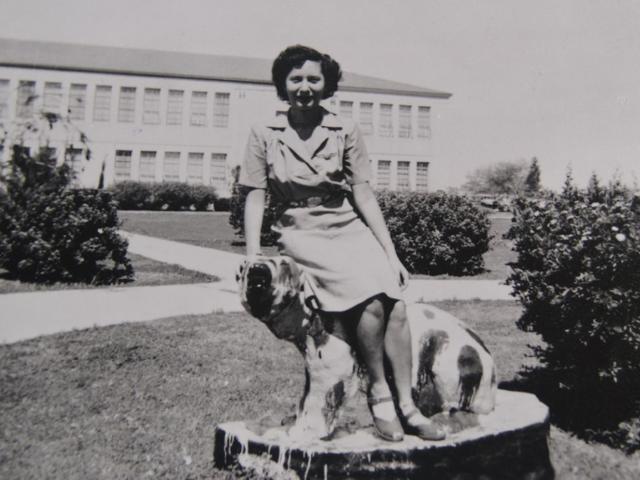 Student sitting on painted Bumstead statue