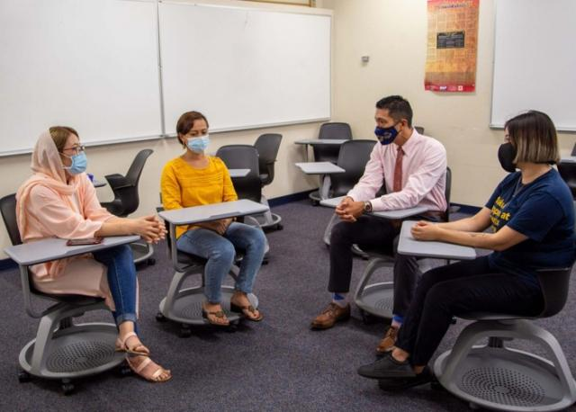Dr. Namuo with Phoenix College Students - Classroom
